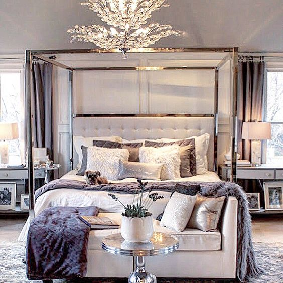 luxurious bedroom decor with a metal frame bed and a tufted headboard