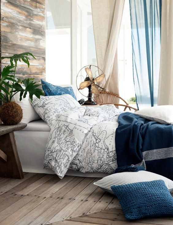 seaside bedroom decor with map bedding to dream of travelling before falling asleep