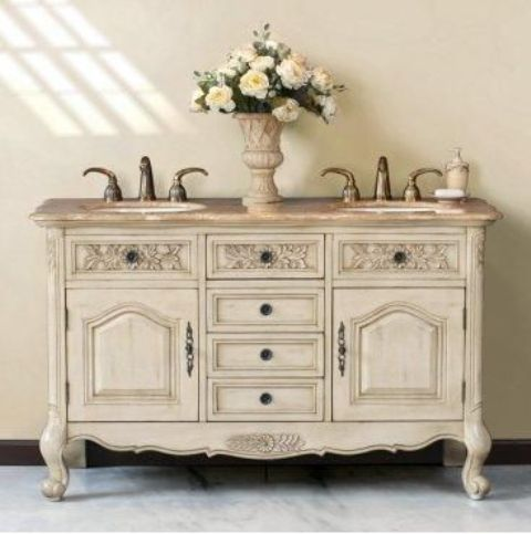 an old buffet from a flea market was painted white and repurposed into a vanity