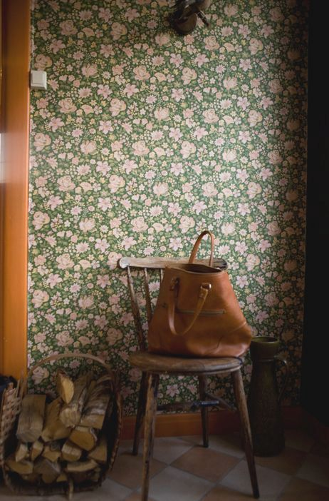 green and pink floral wallpaper for an entryway