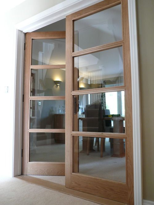 Internal Doors Made From Oak With Glass Paneling Throughout Providing A Simple Yet Elegant Transition