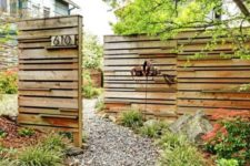 13 rustic wooden fence made of reclaimed wood and placed strategically to cover what's necessary