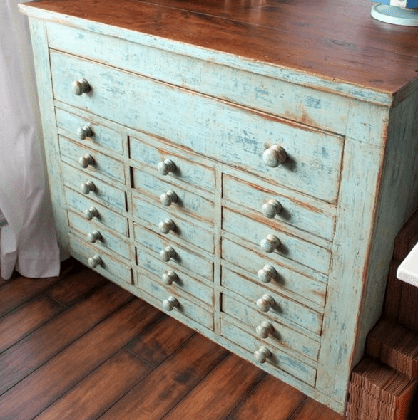 shabby apothecary style dresser with lots of small drawers for a bedroom