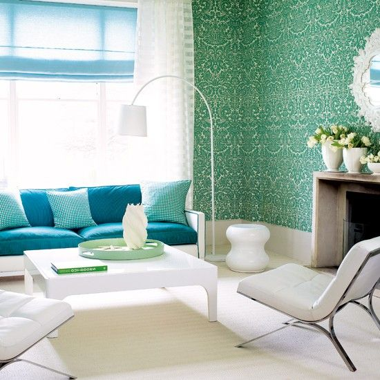 vibrant damask wallpaper and bold blue upholstery complemented with whites
