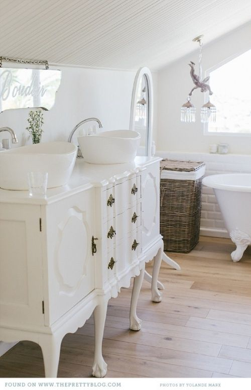 exquisite white French dresser used as a bathroom vanity
