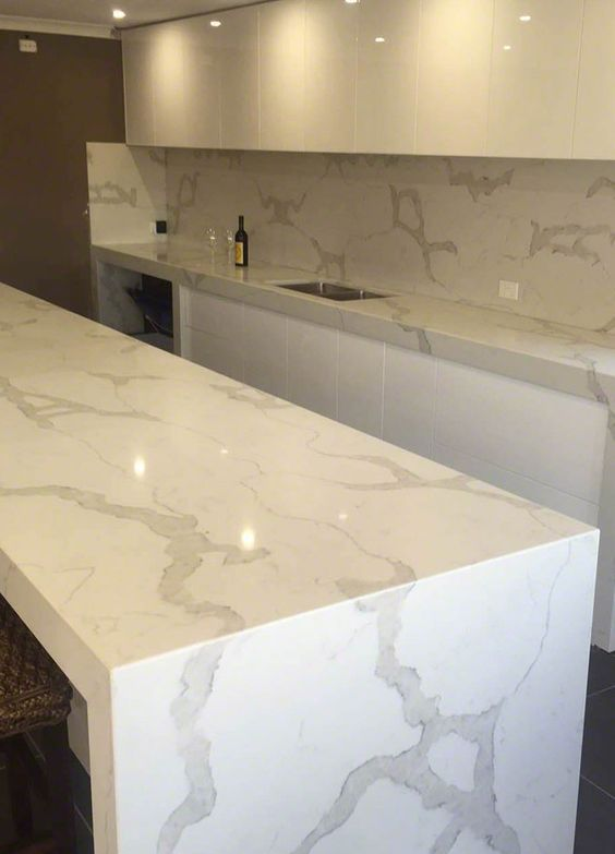 Minimalist White Kitchen With Chic Quartz Counters Looking Like Marble