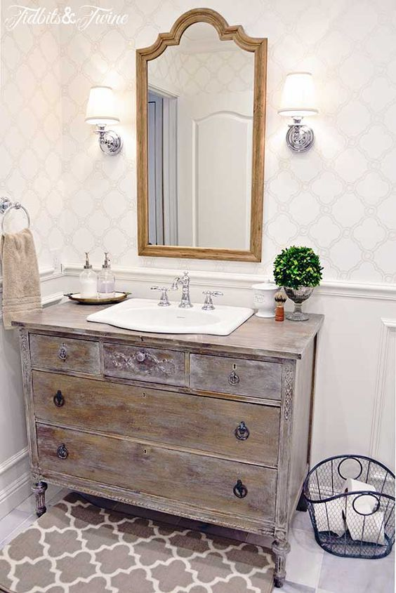 vintage reclaimed wooden sideboard repurposed into a bathroom vanity - 34 Rustic Bathroom Vanities And Cabinets For A Cozy Touch - DigsDigs