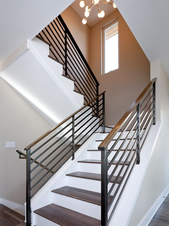 wooden banister and a wrought iron balustrade in modern style look chic and eye-catching