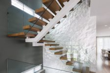 14 your staircase area can be made unique with just one 3D wall