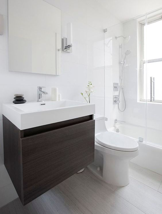a dark floating cabinet with a conctrasting white sink