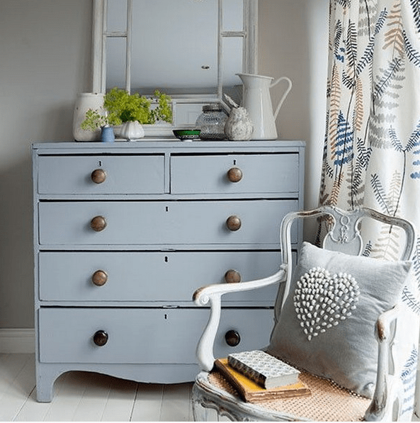 grey dresser with metal knobs for a vintage style bedroom