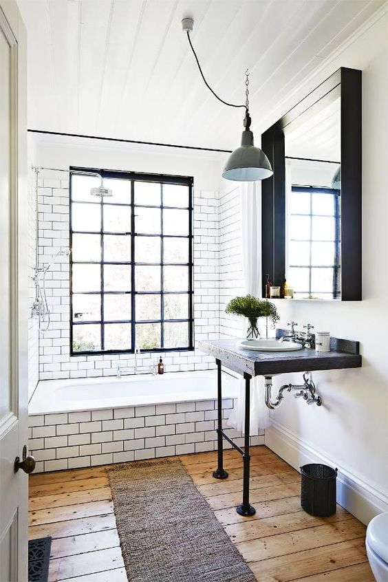reclaimed wood and black pipes countertop for a chic industrial bathroom 32 Trendy And Chic Industrial Bathroom Vanity Ideas  DigsDigs