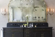 15 refined black vanity with gold contours and a large mirror