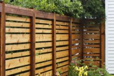 15 simple stained horizontal wooden fence will match any backyard decor