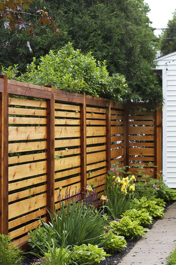 34 privacy fence design ideas to get inspired digsdigs for Decorative fences for backyards