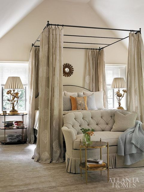 traditional bedroom with a canopy bed, the curtains fit the color scheme perfectly