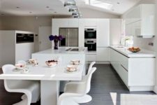 15 ultra-modern white kitchen and a corresponding dining space with sculptrual chairs