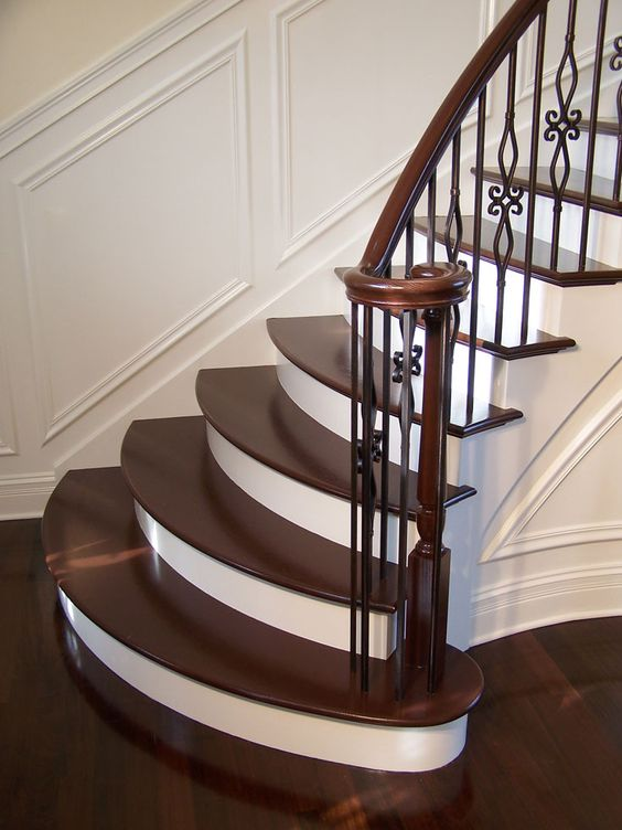 gorgeous wrought iron balluster stairs with painted treads and risers