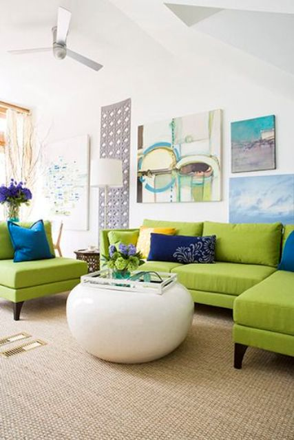 lime green upholstery, blue and navy pillows and art works