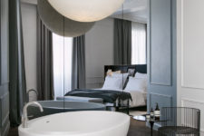 16 modern mirror wall, a free-standing bathtub and an oversized sphere lamp