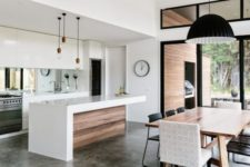 16 sleek white minimalist kitchen and a modern diner connected with colors and pendant lamps