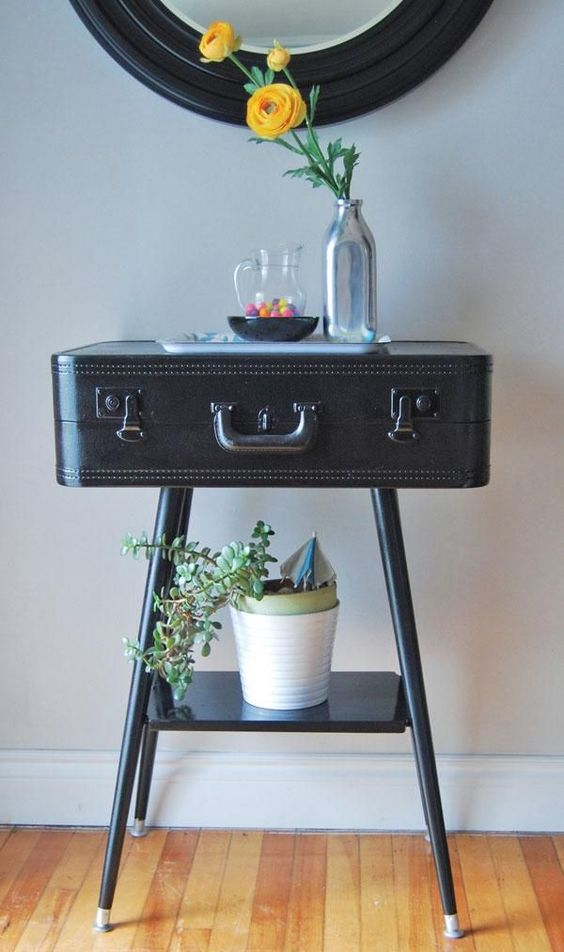 vintage suitcase turned into a console table for an entryway looks cool