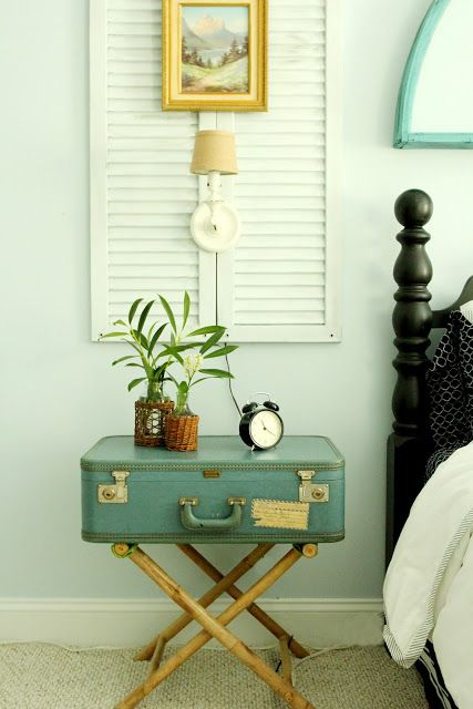 a vintage suitcase can become a great nightstand in your bedroom