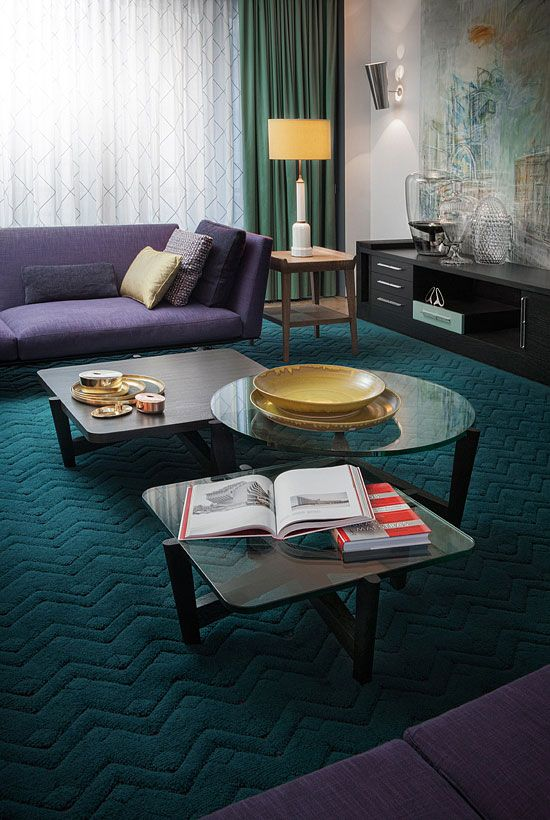 teal, greens and purple upholstery look bold and harmonious