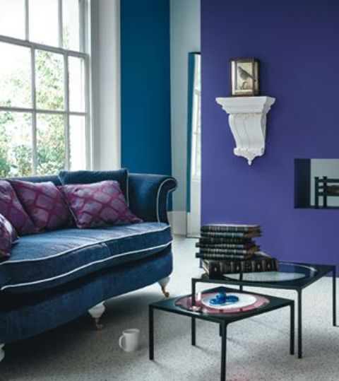 a violet and a teal wall, a teal sofa for a colf refined living room