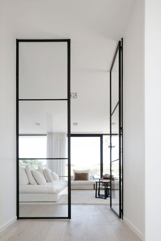 floor to ceiling black framed glass doors look perfect in a neutral modern ambience : inside doors - pezcame.com