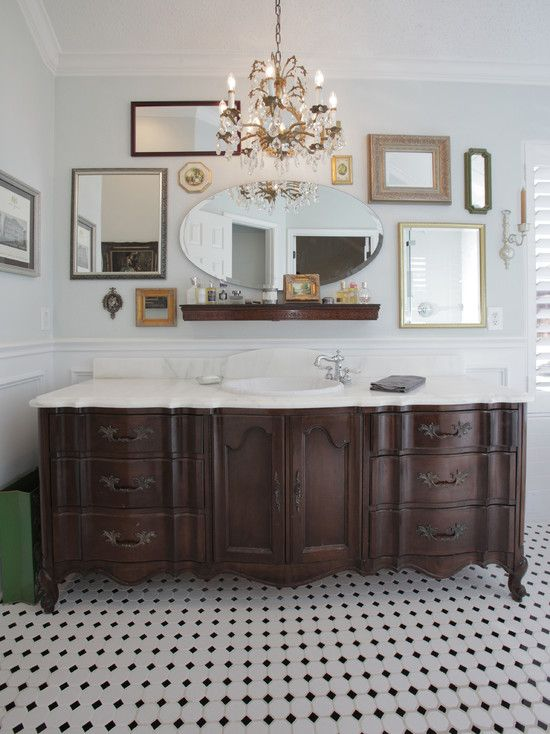 large old dresser turned into a vanity with a white countertop - 29 Vintage And Shabby Chic Vanities For Your Bathroom - DigsDigs