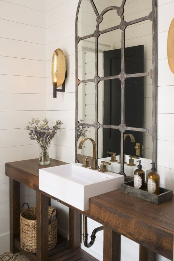 rustic industrial bathroom with a drak stained reclaimed wood vanity and  shelf for storage 32 Trendy And Chic Industrial Bathroom Vanity Ideas DigsDigs