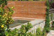 18 wooden privacy fence surrounding a spa outdoors
