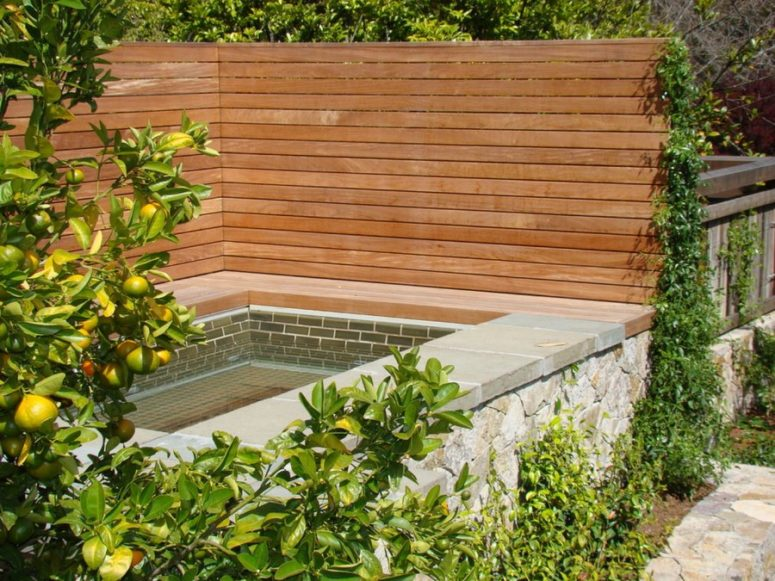 wooden privacy fence surrounding a spa outdoors