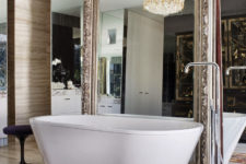 19 a mirror wall and an additional one in a refined frame to give the bathroom a gorgeous look