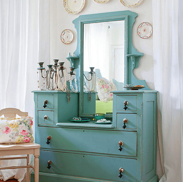aqua-colored dresser used for accessory storage