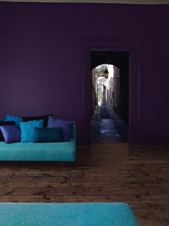 deep purple walls will make the space moody and bright turquoise accessories will enliven it