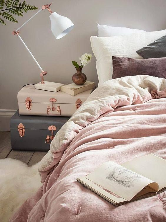 feminine bedroom with two suitcase stacked for a bedside table, they look so dreamy and inspiring