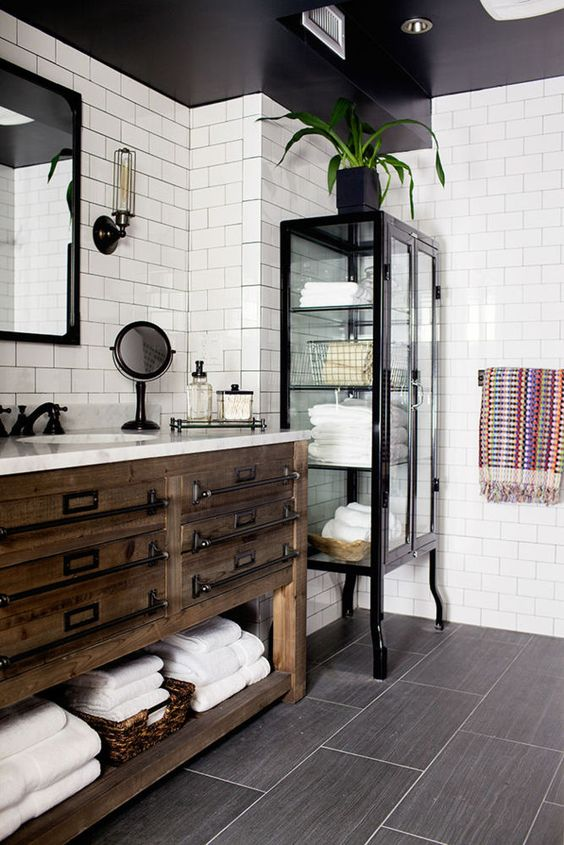 Rustic Reclaimed Wood Bathroom Vanity With Metal Handles And An Open Shelf