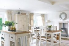 19 serene white kitchen with off-white furniture and a comfy diner by the hearth