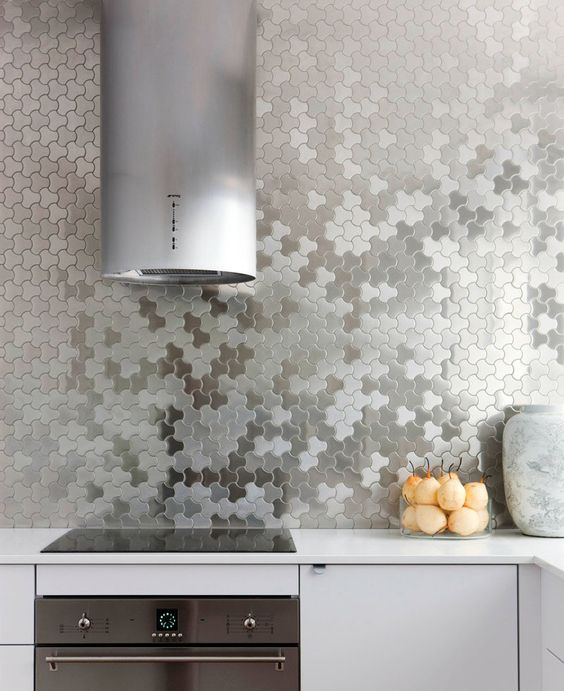 stainless steel puzzle wall covering instead of a kitchen backsplash