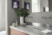 20 a wooden vanity with a concrete countertop for a modern laconic bathroom