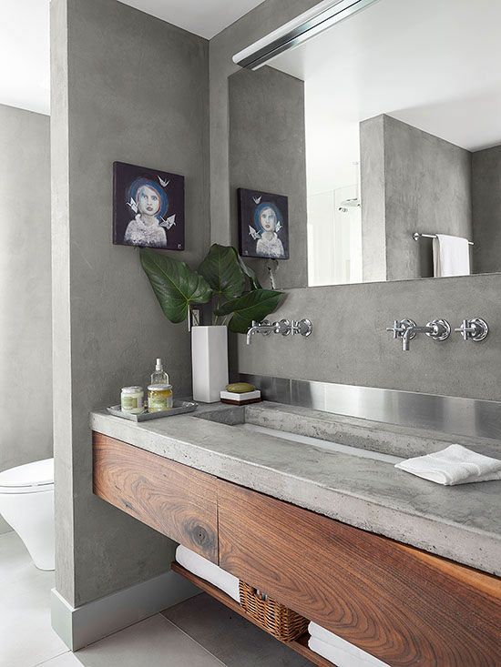 a wooden vanity with a concrete countertop for a modern laconic bathroom