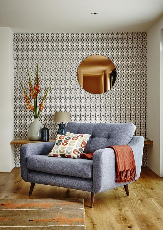 bold geometric wallpaper and mid century modern furniture create a