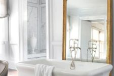 20 large mirror in a refined gilded frame is a great deoc ridea for a bathroom