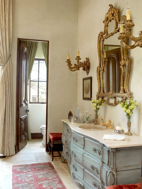 patina-colored refined bathroom vanity with a marble counter
