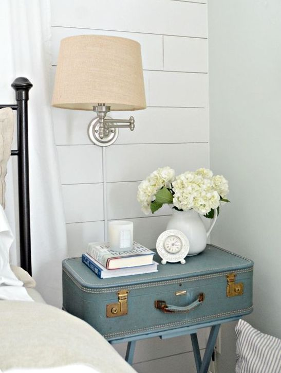 rustic bedroom decor with a vintage suitcase nightstand