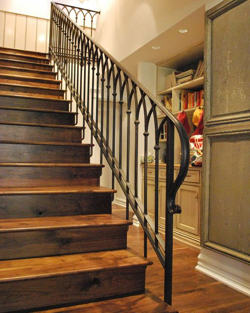 Rustic Stairs Of Wood With A Wrought Iron Handrail And Banister