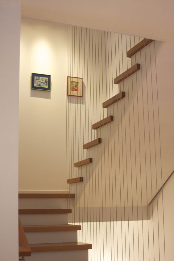 Vertical Cable Railing Gives A Unique Look To This Staircase And Separates  It From The Rest