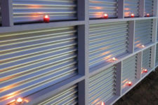 22 a corrugated metal fence can become realyl cool-looking if you place some candles there
